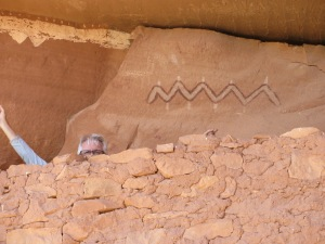 Leonard behind defensive outer wall with pictographs