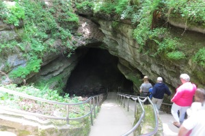 Descending down the original entrance to the cave